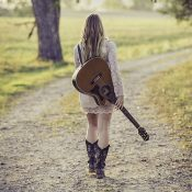 woman-in-white-long-sleeve-dress-carrying-a-guitar-164767